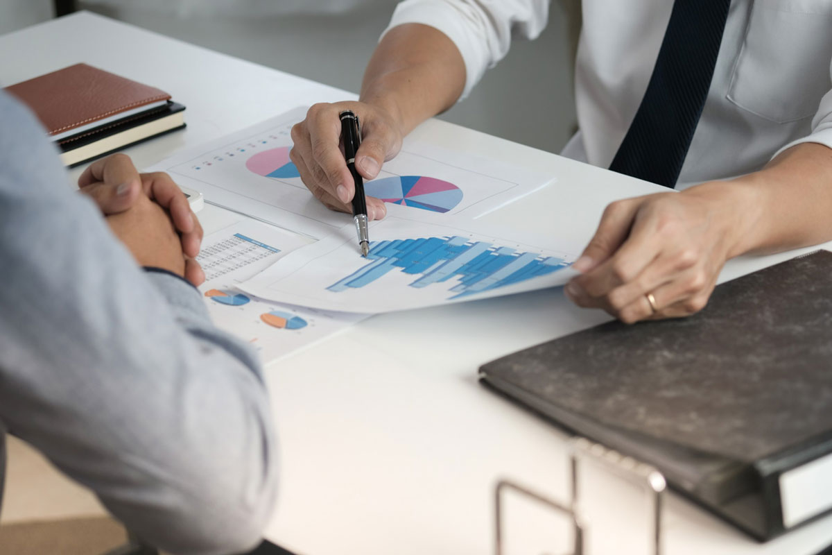 two office staff conducting an internal audit and checking financial documents of a company