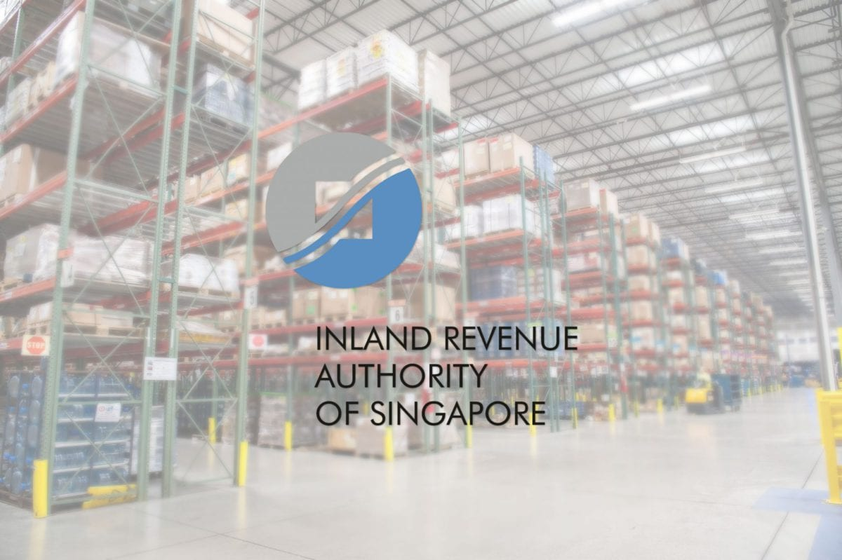IRAS logo overlaying background warehouse example of a GST registered company in Singapore